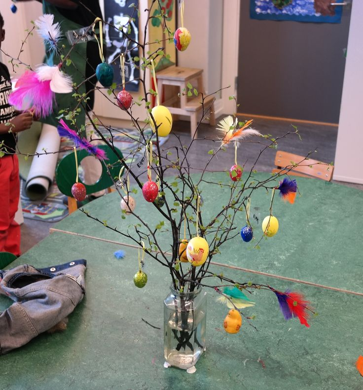 Easter tree! We combined a science project with art in this project. We picked the branches about 3 weeks before Easter and did weekly observations on them, writing and drawing what happened to the branches. Then I bought plastic eggs for everyone to decorate and presto! An Easter tree!!!