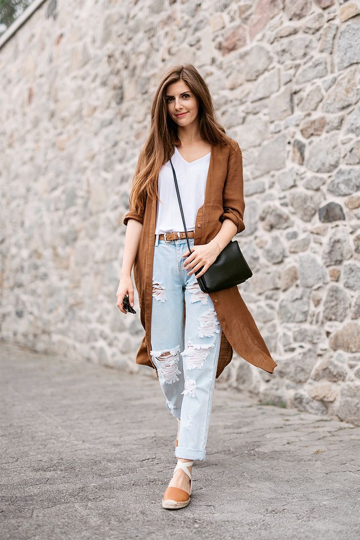 ripped jeans with a light coat and white tee