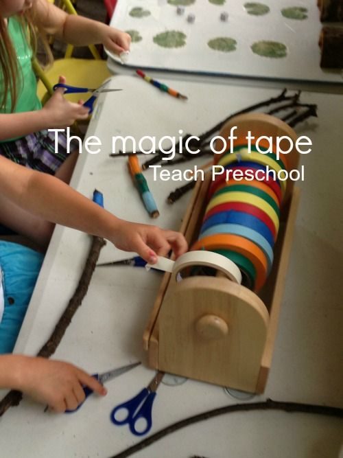 The magic of tape- tape on a paper roll holder for preschoolers