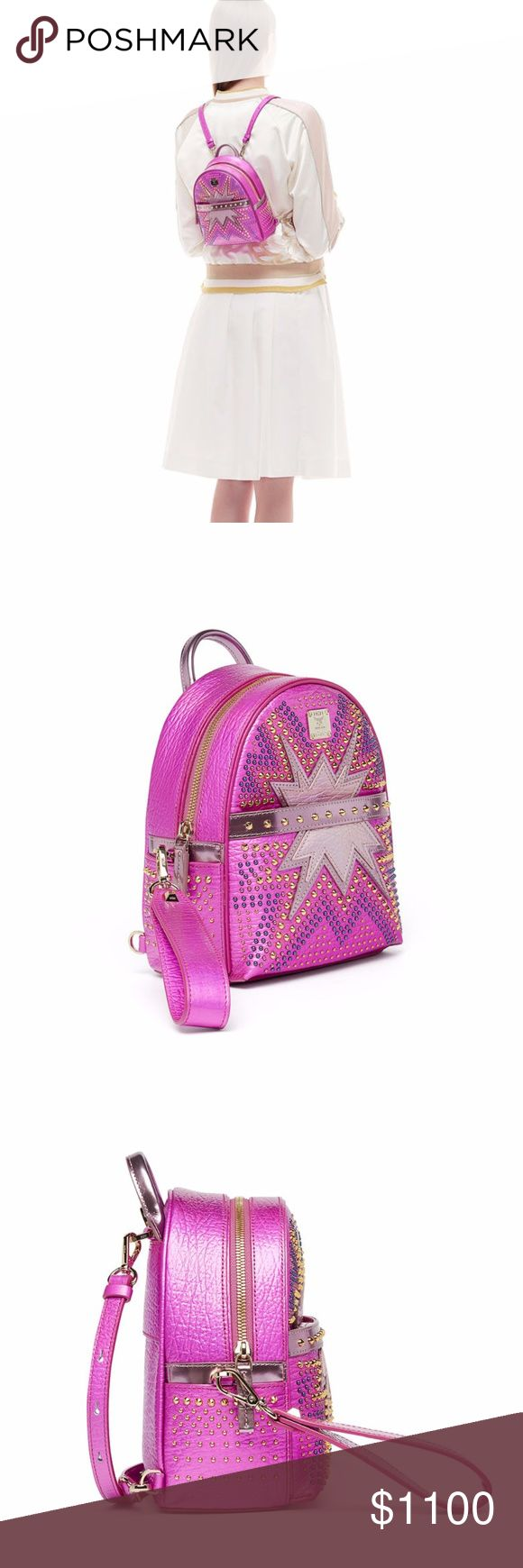 """GORGEOUS MCM PINK BACKPACK 100% AUTHENTIC MCM PINK grained leather backpack with studded front. May also be worn as a crossbody or shoulder bag. Rolled top handle, 2.5"""" drop. Adjustable, convertible shoulder straps, 12-23"""" drop. Zip around top closure. Individually numbered logo plate. Front zip pocket and side slip pockets. Interior, twill lining; two card slots. 8""""H x 6""""W x 3""""D. MCM Bags Backpacks"""