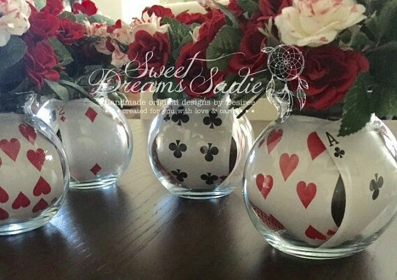Playing cards in vase of roses for centerpiece
