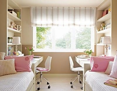 Girls room-Double bed, built in desk, shelving. Striped fabric and pink accents in the room.