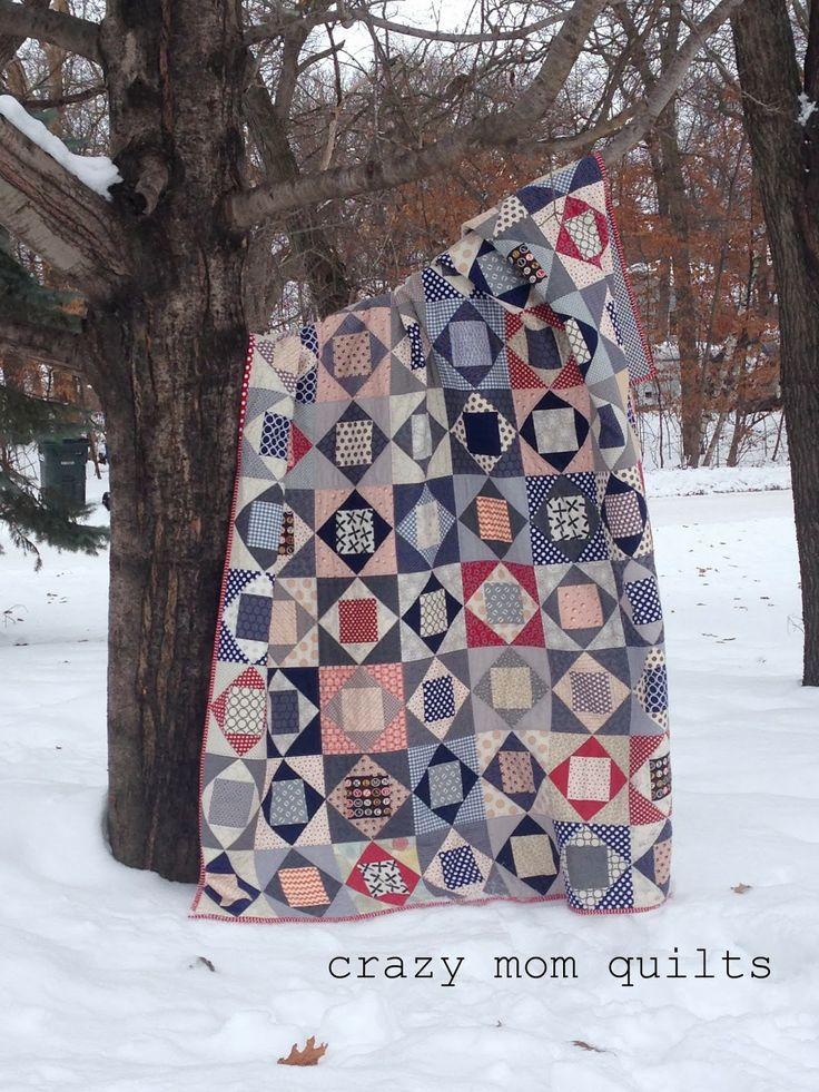 economy block quilt in muted color scheme