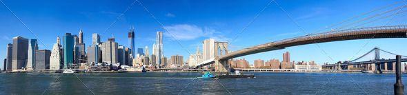 Lower Manhattan panorama by dibrova. Panoramic view of Manhattan skyline and Brooklyn Bridge in New York City