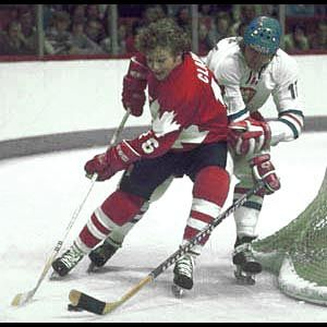 Team Canada forward Bobby Clarke battles Frantisek Cernik of Czechoslovakia during Canada Cup action in 1976. Canada went on to defeat the Czechoslovaks two games to none in the best-of-three game final. (Frank Prazak/HHOF) - Legends of Hockey - Gallery - Pro Classics, 006