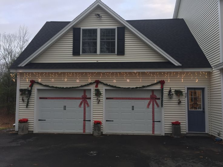 Wrapped Garage Door, Garland, Snow Flake Lights, Poinsettias
