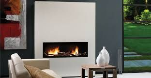 I like the way this fireplace protrudes from the wall and is a contrasting colour.