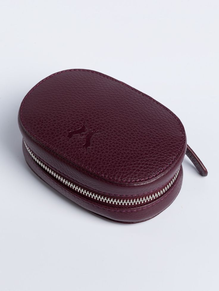 Leather Jewellery Travel Case - Gifts For Her - An elegant and practical travel size jewellery case. Made from burgundy pebble grain leather and lined with cream coloured, softly brushed fabric. Keep necklaces and bracelets secure in the drawstring pouch while the two poppered bands hold earrings and rings.