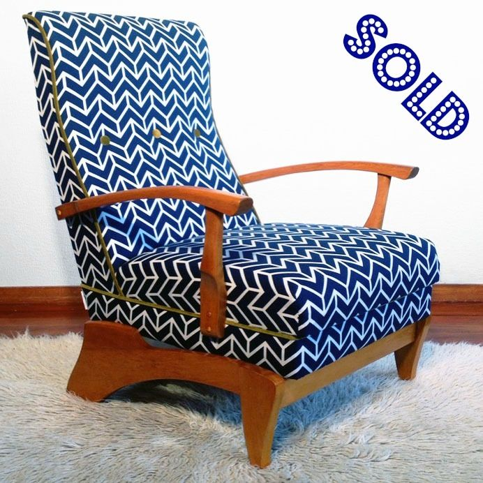 A fully restored mid century rocking chair. The distinctive shape of the base