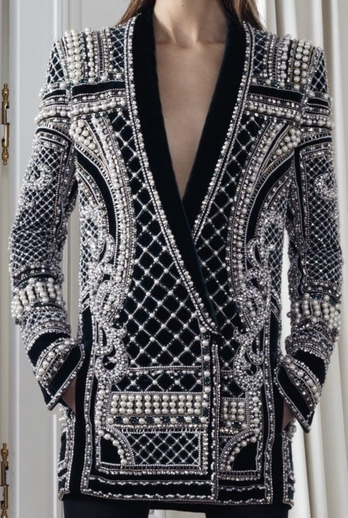 Fascinating jacket....but when or where  would I ever wear it.  Fanceeee.   There's a similar one on this page, too.