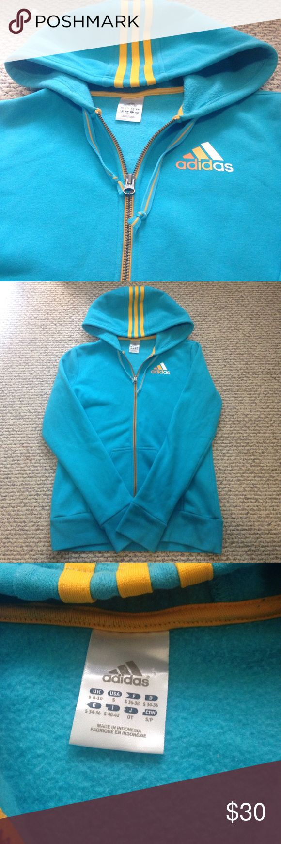Adidas zip up Rare real adidas zip up. Orange, yellow, and white logo with yellow stripes on the hood. Has holes for your thumbs and is in excellent condition! adidas Tops Sweatshirts & Hoodies