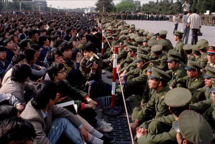 April 18,  1989: STUDENTS PROTEST AGAINST CHINA'S GOVERNMENT    -  Soldiers keep student demonstrators away from the official memorial for Hu Yaobang at the Great Hall of the People, Tiananmen Square in Beijing, where the service is being held. Students tried to present a petition to Premier Li Peng, but were rebuffed.