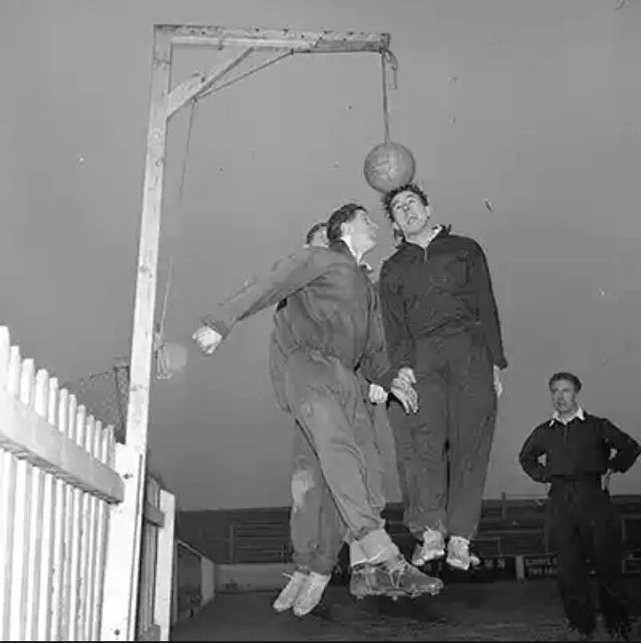1956: Leyton Orient players practice heading with a gallows...