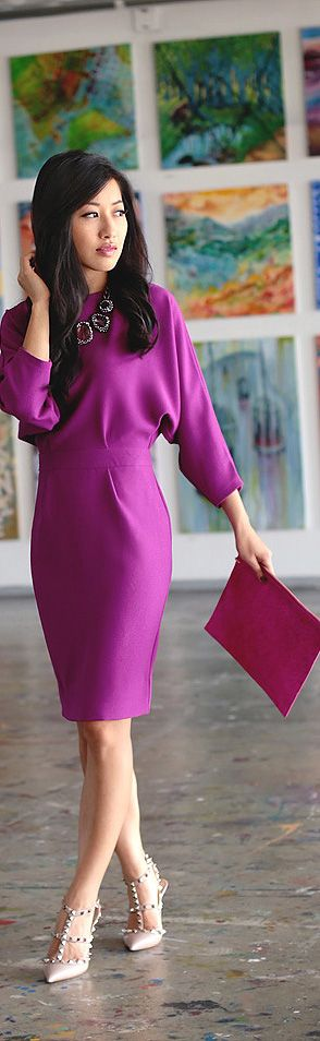 The bold color and sophisticated silhouette of this dress command attention. And I love the Valentino shoes with it.
