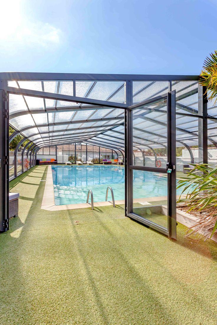 une piscine dont on peut profiter plus longtemps grâce à l'abri de piscine #abripiscinerideaupro