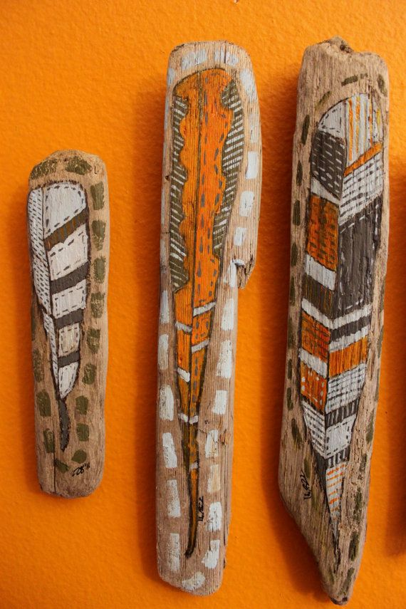 painted driftwood feathers. so very man cave..
