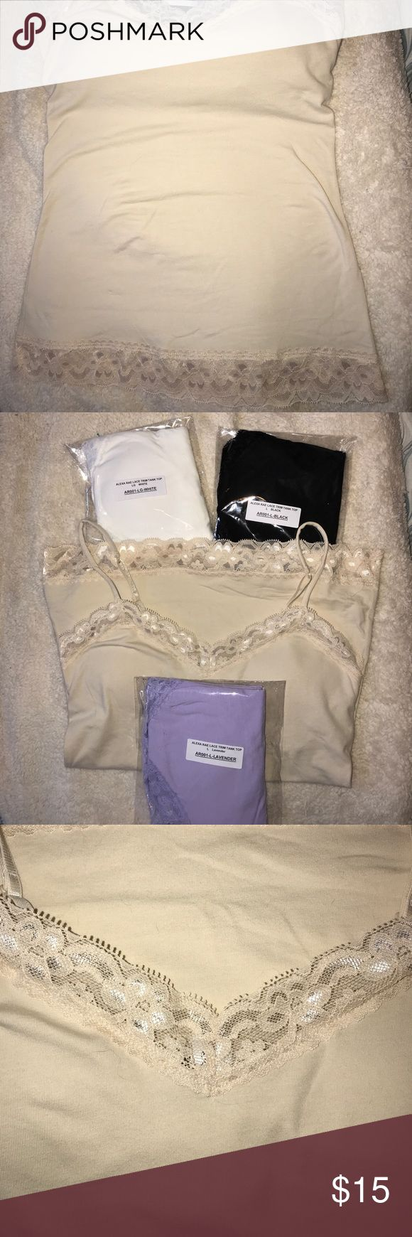 JUST ADDED 4 CAMISOLE BUNDLE NW/OT Alexa Rae lace tank tops with shelf bra, padded. Pads can be removed. 1 white, 1 black, 1 cream and 1 lavender. They all go as a bundle. Size large but fits like a medium. Alexa Rae Tops Camisoles