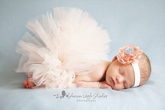Sweet Peaches and Cream Newborn Tutu and Flower Headband: Your little ballerina will look lovely in this tutu and headband set ($40). With a touch of vintage elegance and serious girlie-girl style, it's a perfect set for birth announcement pics.