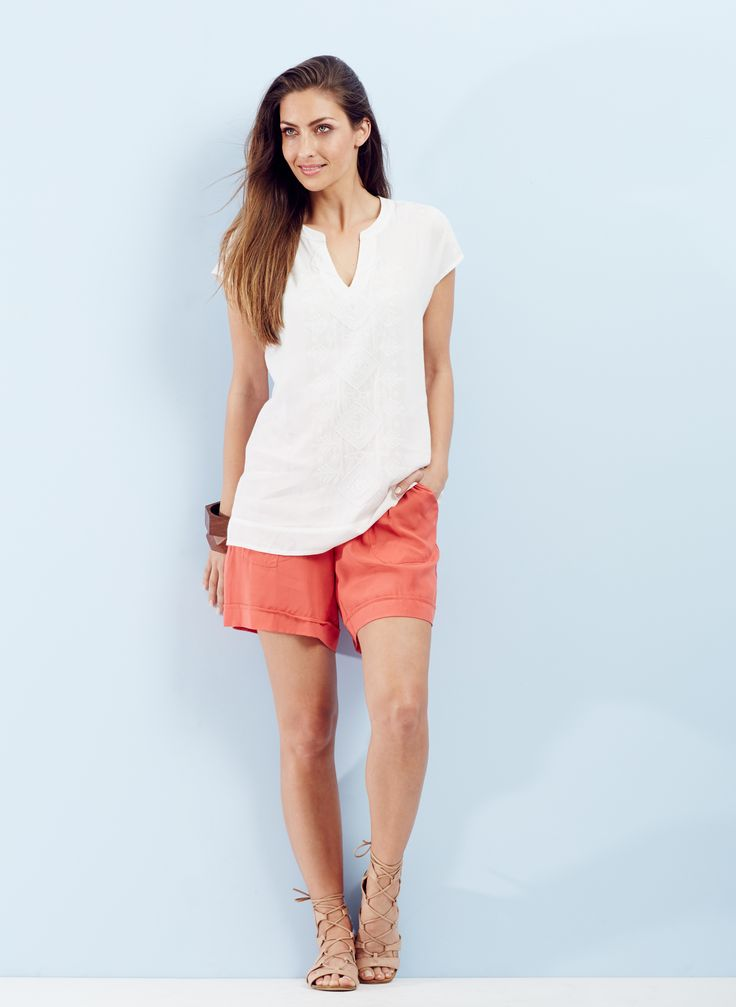 Beach Getaway - A soft short in a summery terracotta tone and nude sandals is the go-to for effortless weekend style.