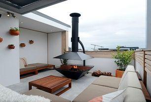 Contemporary Deck with exterior stone floors, Estia Design Fireplace, Cushion Source Custom Bench Cushions - Standard Comfort