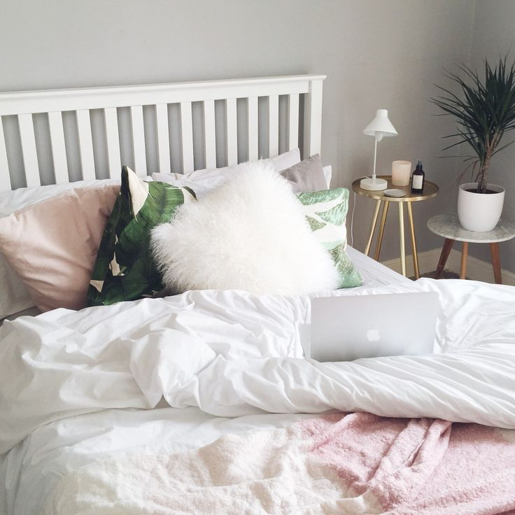 White, blush and grey bedroom with green palm tree accents
