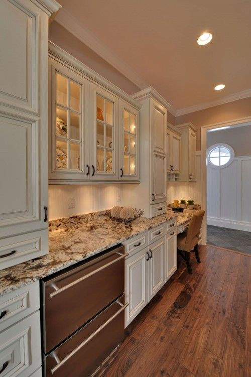 I am really starting to like cream colored cabinets. I also love the wood floor for our kitchen.