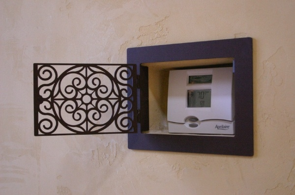 Hide Thermostat With Steel Grate Living Rooms