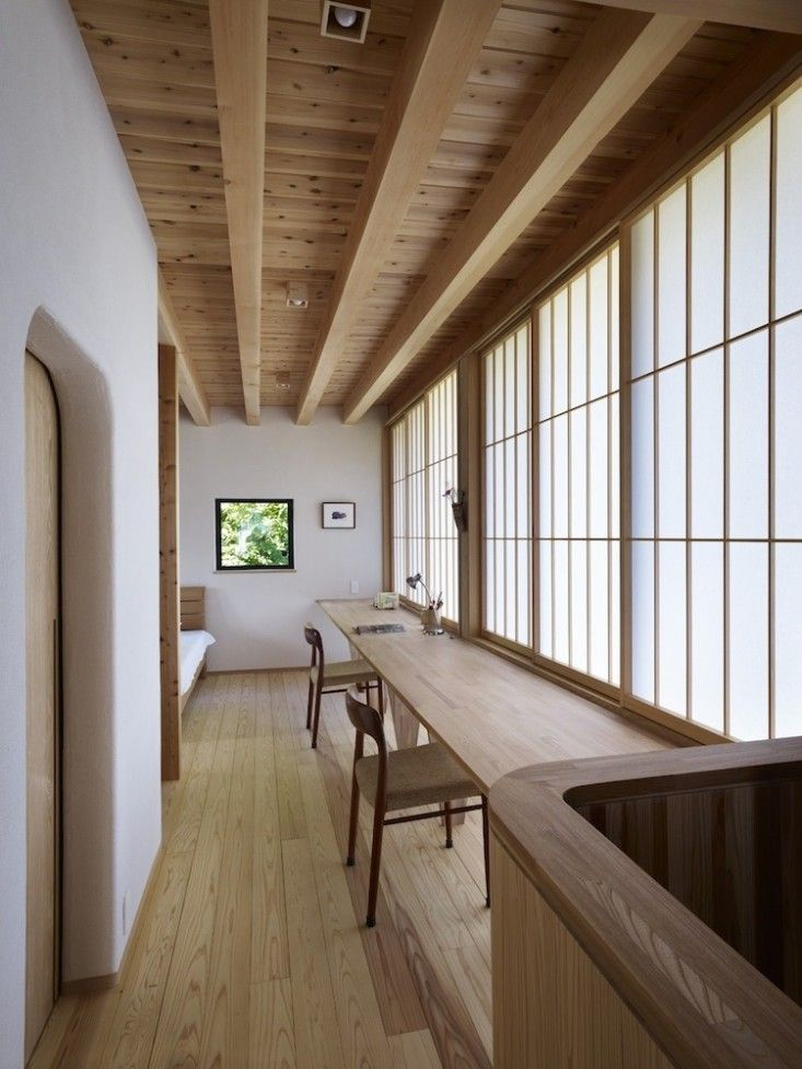 Long wood desk against wall of shoji screens in bedroom of Yatsugatake Villa in Hokuto-Cotu, Japan by MDS Architects, Photo by Toshiyuki Yano | Remodelista