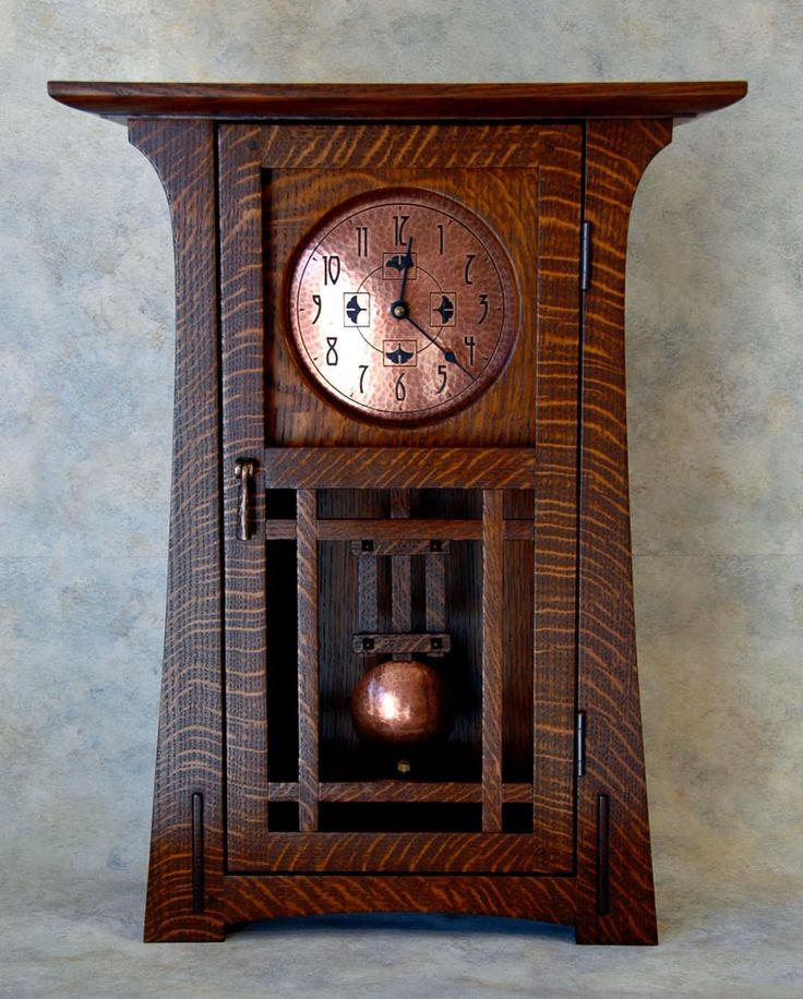 The Arts & Crafts Studio - Arts & Crafts Clock. Quartersawn Oak with Hammered Copper Dial & Pendulum. California. Circa Early-21st Century.