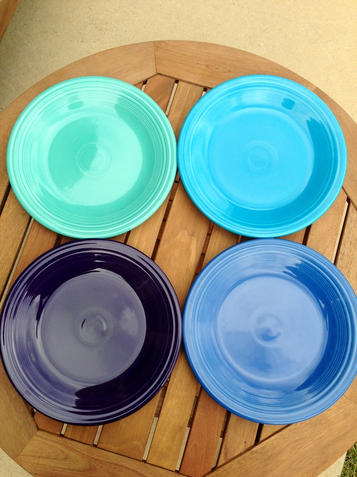 Turquoise, peacock, plum, and lapis.  Fiestaware dinner plates.