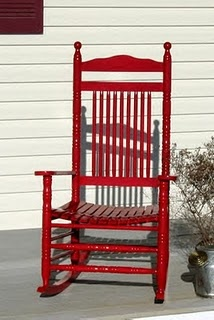 red rocking chair - I have a chair just like this but white. I may have to paint it! :)