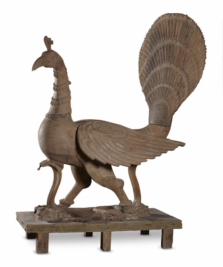 This large figure of a peacock or #mayil was intended as one such ceremonial #vahana. Unusually large, the peacock is treated naturalistically, its powerful frame resting on enormous legs holding down a rearing cobra. he figure may have originally been clad in silver sheet metal or painted. The peacock is associated with #Kartikeya, the son of Shiva,#TamilNadu, #Chennai, district, Late #18thcentury