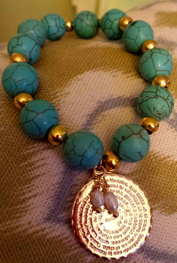 Turquoise beads bracelet featuring a Padre Nuestro charmCharm: double sided engravingWater pearls100% gold filledYour order will be delivered 1-3 business days after payment confirmation.Special orders accepted. Send a note to PrettyGioielli for any requests.