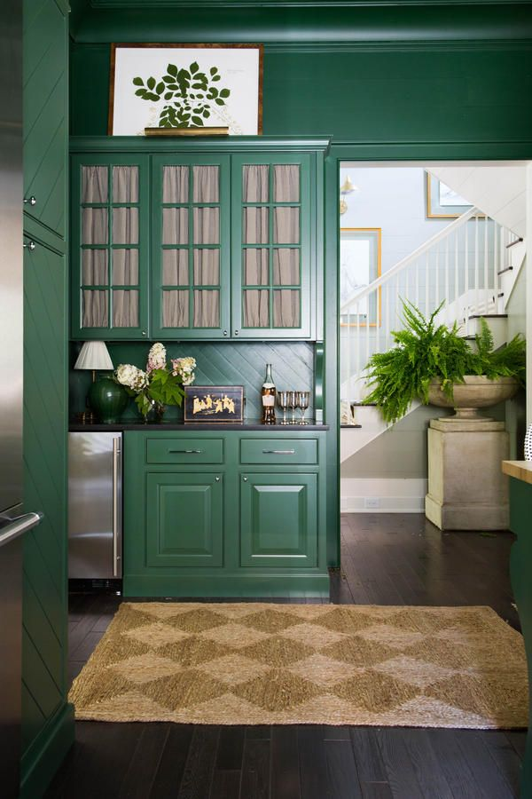 Built-In Butler's Pantry - Idea House Kitchen by Bill Ingram - Southernliving. With ample room for drinks and hors d'oeuvres, the counter space is functional, yet provides sleek counterspace for large gatherings. Overhead cabinets, backed with Black Pinstripe Cotton curtains, by Serena