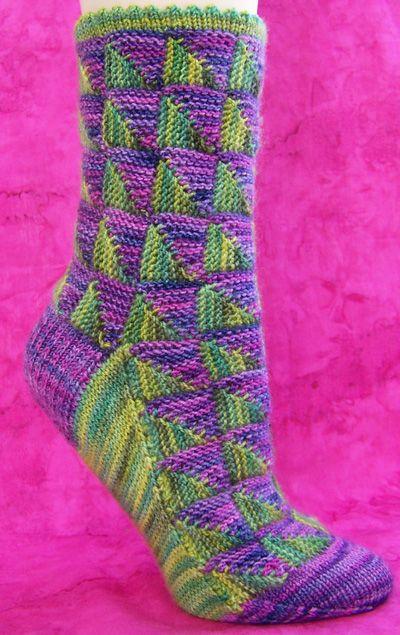 Posey socks - Spring 2008 - Knitty. Way cooler than my mitered square socks.