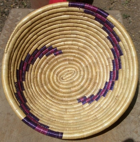 """africanartonline.com - African Woven Grass Basket made from local grasses in East Africa.  A feast for the eye of color, patterns and textures.  Parts of the grass bowl have been dyed to create this wonderful eye catching basket.  One in stock only.  Dimensions W""""9"""" H""""4"""" https://africanartonline.com/african-woven-grass-basket-on-sale-now/"""