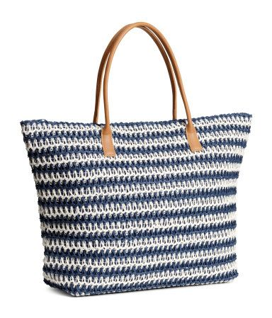 Blue/Striped. Soft straw bag with two imitation leather handles and a zip at the…