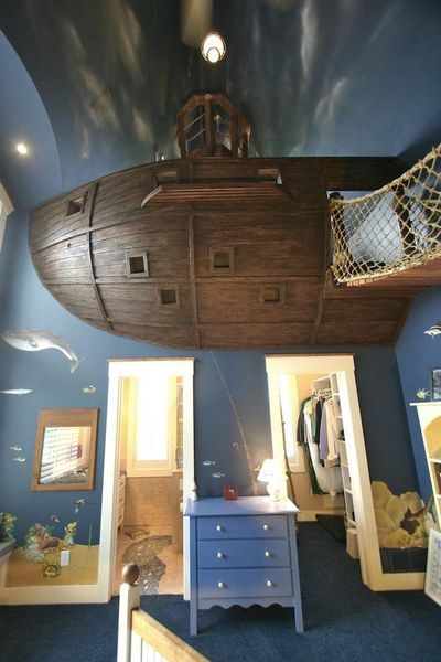 Pirate ship kids bedroom.  The amazing part is that boat actually looks like a boat inside! AND there is a slide from this top story bedroom (in the boat) to the bottom floor. FANTASTIC