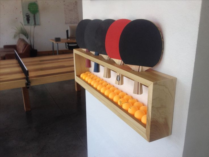 Ping pong paddle shelf / holder I made for my office. Keeps everything organized, 5 paddles and a bunch ping pong balls. DIY.