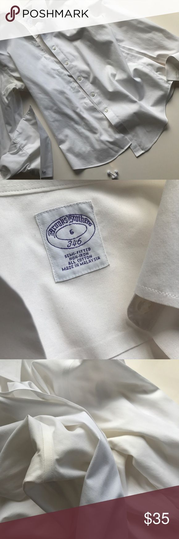Brooks Brothers White Button Down Cuff Blouse Great for work! Including an extra pair of cuff links! Slight discoloration under arms as shown but not noticeable and bleachable! Beautiful non iron shirt Brooks Brothers Tops