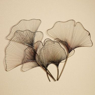 """Ginkgo Breeze Metal Wall Sculpture  Measures 44""""x30"""".  • Metal wall sculpture with interesting ginkgo leaf design • Ginkgo leaves overlap for a unique appearance  139"""