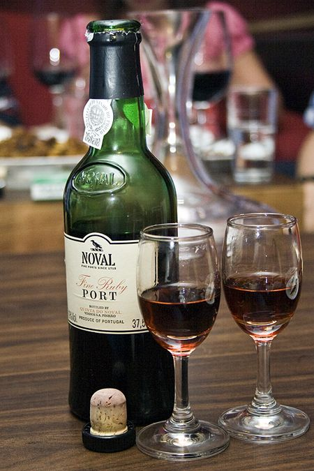 Port Wine (also known as Porto or simply Port) is a Portuguese wine. It is produced from grapes grown and processed in the Douro region in Portugal. It is typically a sweet red wine, but also comes in dry, semi-dry and white varieties. It is often served as a dessert wine.