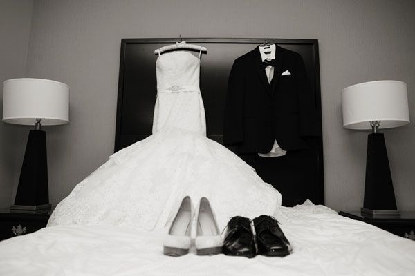 NEED THIS SHOT!! Most photographers will capture a photo of your dress and shoes before you put them on; sweeten the shot by adding your groom's attire, too!