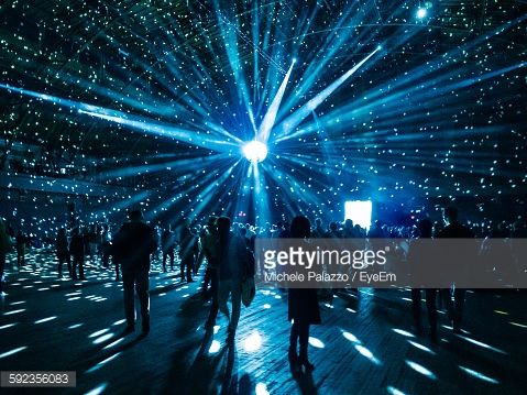 Stock Photo : Illuminated Disco Ball Over Silhouette People In Nightclub