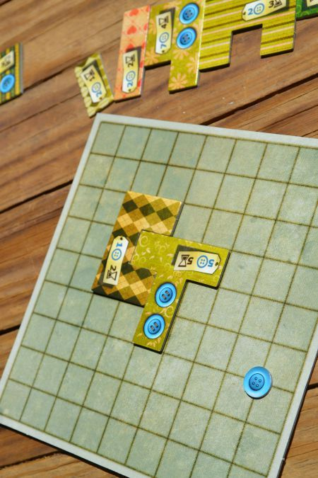 Patchwork board game, a ridiculously fun two player game with a quilting theme and a bit of Tetris-like game play.