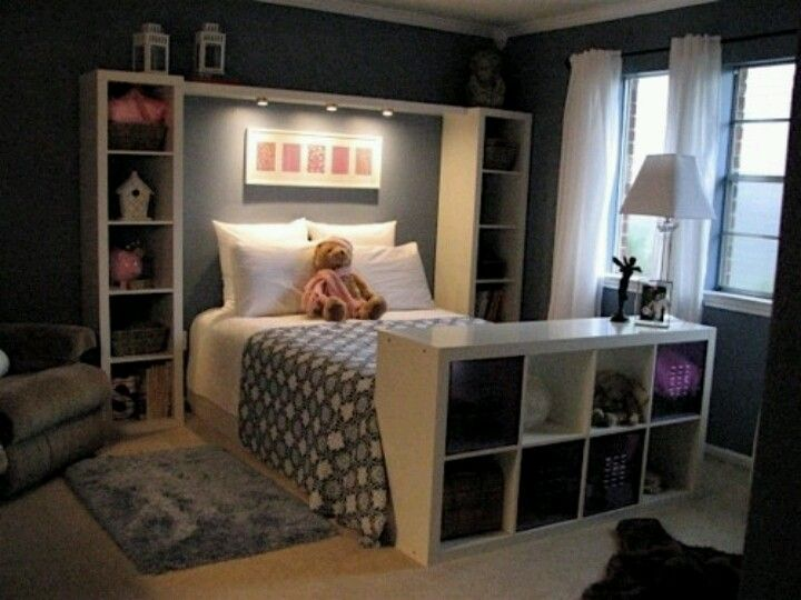 DIY headboard/footboard made with Ikea storage shelves.