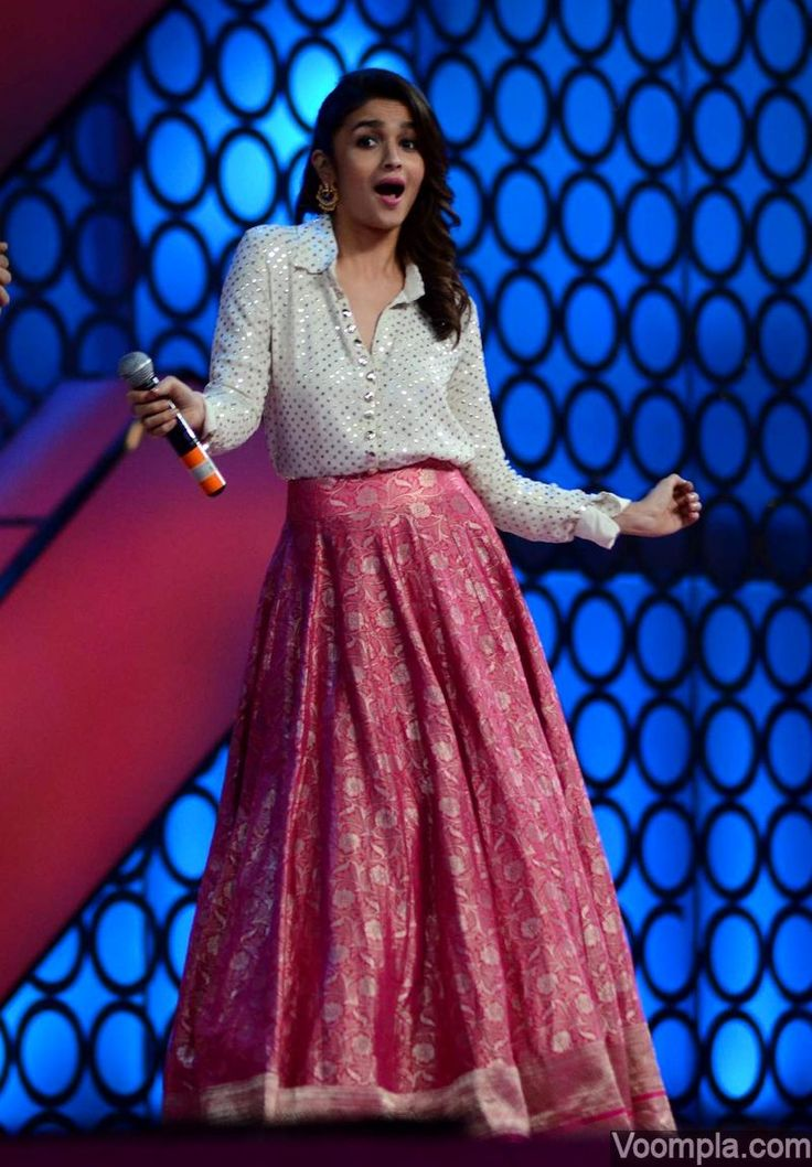 Alia Bhatt charms everyone with her cute dance moves at a recent function, wearing a glittering white top and a long pink lehenga by designer Manish Malhotra. via Voompla.com