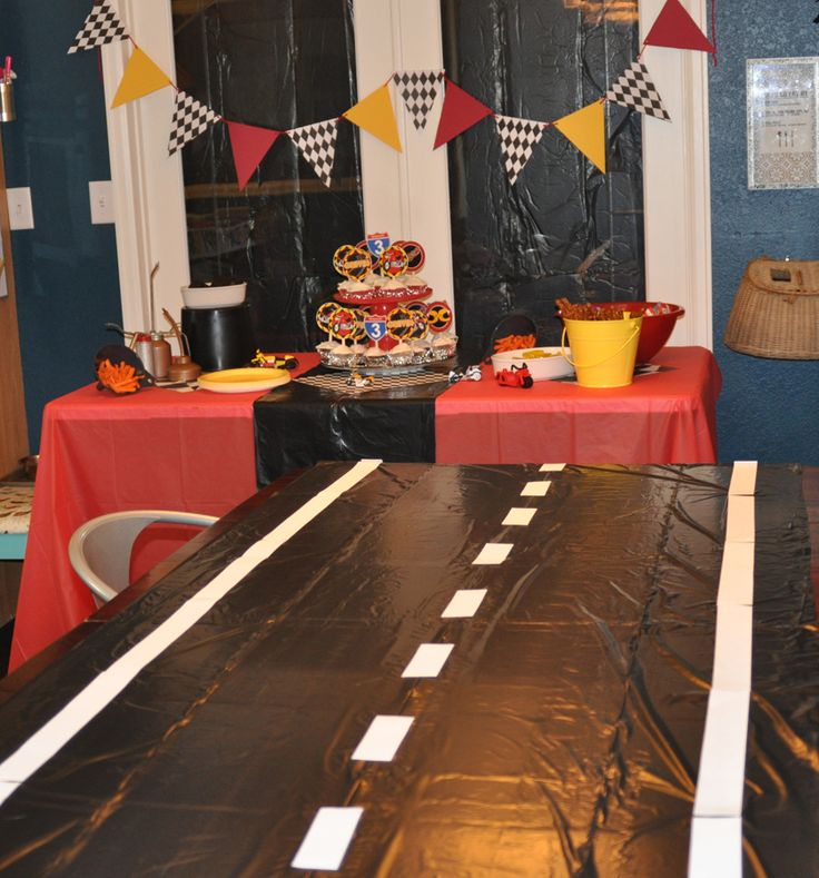 Motorcycle birthday. Table cover is black garbage bags with white paper stripes taped on.