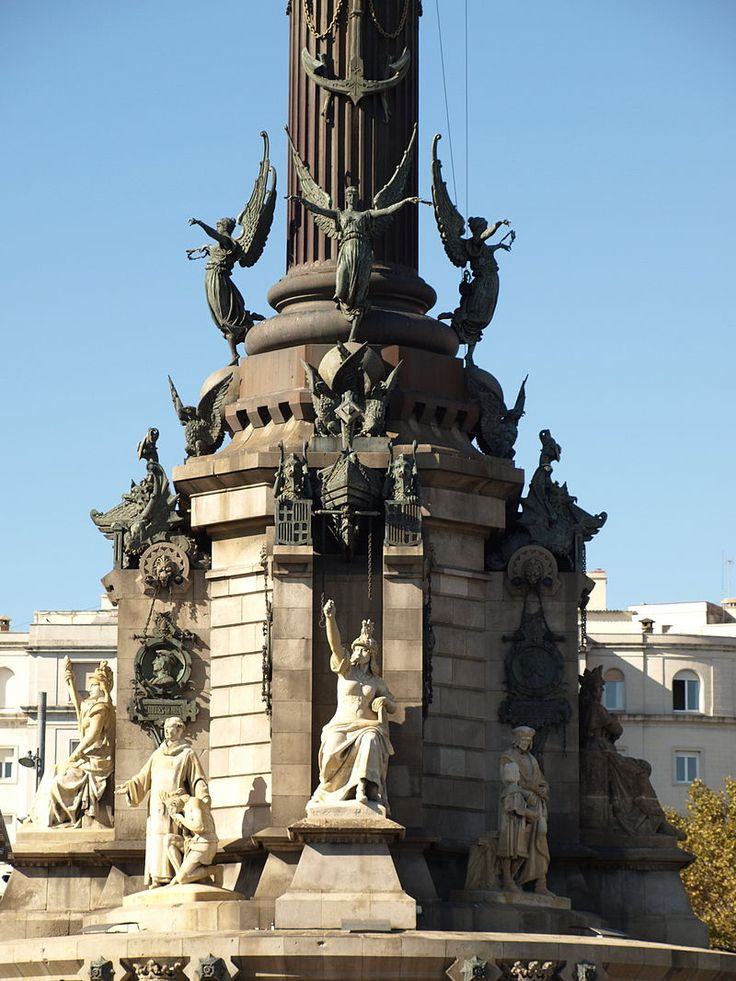 This image shows the pedestal of the Christopher Columbus Monument located at the end of Las Ramblas. The pedestal shows 4 winged victories taking flight toward the 4 corners of the world, a pair of griffins, and 8 persons important to the life of Columbus, including Martín Alonzo Pinzón, Vicente Yáñez Pinzón, Ferdinand II of Aragon, Isabella I of Castile, Father Juan Pérez and Anonio de Marcehna, Andrés de Cabrera, and Beatriz Fernández de Bobadilla.