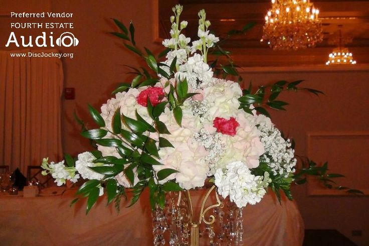 Just a sample of the elegant floral arrangements at Kate and Rich's wedding.